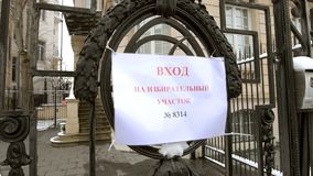 Russian presidential election 2018 with senior Russian male ente. STRASBOURG, FRANCE - MAR 18, 2018: Polling station sign on the gate of Consulate General of the Royalty Free Stock Photography