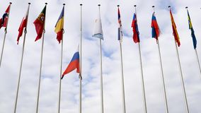 View from below of waving Russian Federation flag half-mast. STRASBOURG, FRANCE - MAR 28, 2018: Russia flag flying half-mast at Council of Europe - tribute and stock video footage