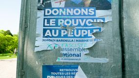 Jordan Bardella and Marine Le Pen Rassemblement National. Strasbourg, France - May 23, 2019: Slow pan over damaged Posters in green sunny park for 2019 European stock video footage