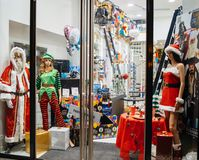 Christmas-themed costumes worn by mannequins Stock Photo