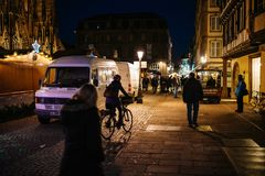 Pedestrians and cyclist near the Christmas stalls walking at nig Royalty Free Stock Photography