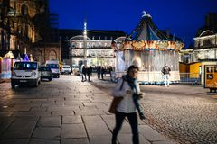 Pedestrians walking near the closed merry-go-round attraction Ch Stock Photos