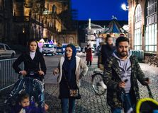Young muslim family walking at night a day before the official i Stock Photography