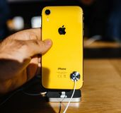 Customer POV holding new yellow iPhone XR stock image