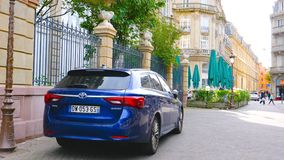 Electric Toyota Avensis parked in central Strasbourg. STRASBOURG, FRANCE - OCT 1, 2017: Latest model of luxury Toyota Avensis wagon car parked on the streets of stock video footage