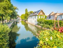 Strasbourg, France - Picturesque canals in La Petite France in the medieval fairytale old town of Strasbourg. royalty free stock image