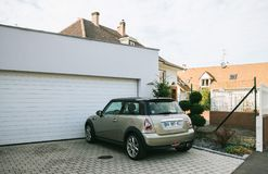 Mini cooper car parked in front of house Stock Image