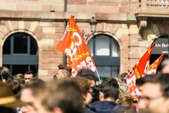 Place kleber political march during a French Nationwide day agai. STRASBOURG, FRANCE - SEPT 12, 2017: Real French protestors with communist flags political march Stock Photo