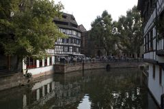 Strasbourg, France - September 3, 2015: Houses near the La Maiso. N des Tanneurs restaurant. It was constructed in 1572 and became a restaurant in 1949, then it stock images