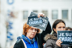 Strasbourg holds silent vigil for those killed in Paris attack. STRASBOURG, FRANCE - JANUARY 09, 2015: Council of Europe employees holding JE SUIS CHARLIE poster Royalty Free Stock Image