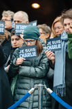 Strasbourg holds silent vigil for those killed in Paris attack. STRASBOURG, FRANCE - JANUARY 09, 2015: Council of Europe employees holding JE SUIS CHARLIE poster Royalty Free Stock Photography