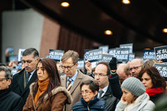 Strasbourg holds silent vigil for those killed in Paris attack. STRASBOURG, FRANCE - JANUARY 09, 2015: Council of Europe employees holding JE SUIS CHARLIE poster Royalty Free Stock Photos