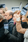 Strasbourg holds silent vigil for those killed in Paris attack. STRASBOURG, FRANCE - JANUARY 09, 2015: Council of Europe employees holding JE SUIS CHARLIE poster Stock Image