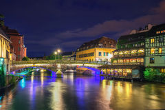 Strasbourg, Petite France at night. Strasbourg, Petite France quarter and the river Ill with reflections of lights at night Royalty Free Stock Photos