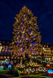 Strasbourg's Christmas Tree and Village. Strasbourg's Christmas Tree and miniature village at night Royalty Free Stock Image