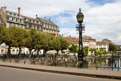 Strasbourg`s cityscape with Ill river, a bridge and a street lamp. Strasbourg is the capital and principal city of the Alsace region and is the official seat of stock photos