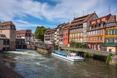 Strasbourg's cityscape with the Ill river and a touristic boat Stock Photo