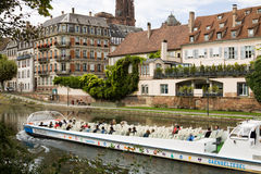 Strasbourg's cityscape with the Ill river and a touristic boat Stock Images
