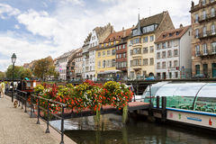 Strasbourg's cityscape with a sight-seeing boat on Ill river Stock Image