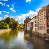 Strasbourg, water canal in Petite France area, Unesco site. Alsace. Strasbourg, water canal in Petite France area. Half timbered houses and trees in Grand Ile royalty free stock image