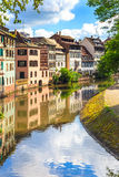 Strasbourg, water canal in Petite France area, Unesco site. Alsace. Strasbourg, water canal in Petite France area. Half timbered houses and trees in Grand Ile stock photography