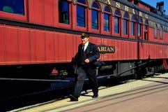 Strasburg, PA: Conductor and Railroad Cars Royalty Free Stock Photo