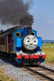 The Thomas the Tank Engine in Lancaster County PA. Strasburg, PA, USA – June 19, 2016: Thomas the Tank Engine chugs toward the train station in Strasburg Royalty Free Stock Images