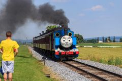 Thomas the Tank Engine in Lancaster County PA. Strasburg, PA, USA – June 19, 2016: Thomas the Tank Engine chugs toward the train station in Strasburg Stock Photography