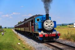 Thomas the Tank Engine in Lancaster County. Strasburg, PA, USA – June 19, 2016: Thomas the Tank Engine chugs toward the train station in Strasburg, Lancaster Stock Images