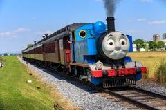 The Thomas the Tank Engine in Lancaster County. Strasburg, PA, USA – June 19, 2016: Thomas the Tank Engine chugs toward the train station in Strasburg Royalty Free Stock Photos