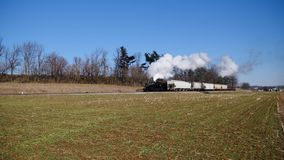 Strasburg, Pennsylvania, February 2019 - Steam Freight and Passenger Combo Train on a Sunny Winter Day stock video