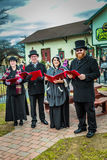 Strasburg Rail Road Christmas Carolers. Strasburg, PA - December 3, 2016: Carolers sing traditional Christmas songs for passengers as they board a train at the stock images