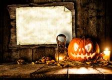 Straszna Halloween bania z puste miejsce deską Zdjęcia Stock