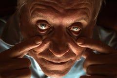 Straszni starszego mężczyzna oczy Zdjęcia Royalty Free