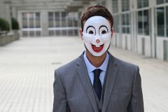 Straszny biznesmen jest ubranym maskę Fotografia Stock