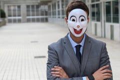 Straszny biznesmen jest ubranym maskę Zdjęcia Stock