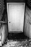 Straszny Suterenowy drzwi Fotografia Stock