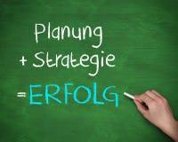 Strategi och erfolg för manhandstilplanung Arkivfoto