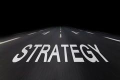 Strategia scritta su asfalto Fotografie Stock
