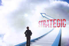 Strategic against red staircase arrow pointing up against sky Royalty Free Stock Image