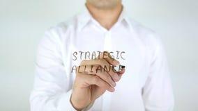 Strategic Alliance, Man Writing on Glass. High quality Royalty Free Stock Image