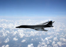Strategic bomber. Modern strategic nuclear bomber flying at high altitude Stock Photography