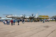 Strategic bomber Tu-95 Bear. Kyiv, Ukraine - April 26, 2015: Strategic bomber Tu-95 Bear is in the State Museum of Aviation.People walk viewing the exhibits of Stock Photo