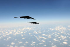 Strategic bombers in flight. Two modern stealth bombers flying at high speed Royalty Free Stock Photo