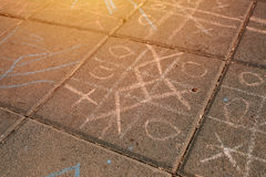 Strategic game of tic tac toe. Played on street pavement, selective focus Stock Photography