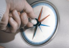 Strategic Management, Business Shift Strategy. Hand turning an orientation knob on a compass to change course. Concept of career shift. Composite image between a Stock Photography