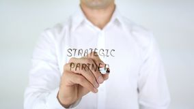 Strategic Partner, Man Writing on Glass. High quality royalty free stock photo