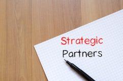Strategic partners write on notebook. Strategic partners text concept write on notebook Royalty Free Stock Images