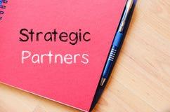 Strategic partners write on notebook. Strategic partners text concept write on notebook Royalty Free Stock Image
