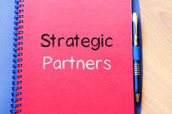 Strategic partners write on notebook. Strategic partners text concept write on notebook Royalty Free Stock Photo
